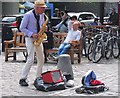 NT2573 : Street performer in the Grassmarket (2) by Jim Barton