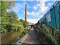 SJ9398 : Ashton Canal and Junction Mill chimney by Gerald England