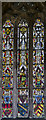 SK9303 : Medieval stained glass, St John the Baptist, North Luffenham by Julian P Guffogg