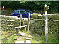SE0522 : Stile and signpost on Sowerby Bridge FP94 at Long Lane, Norland by Humphrey Bolton