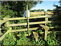 SP6037 : Stile and ominous notice by Jonathan Thacker