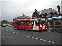 SJ5990 : Bus on Longshaw Street, Dallam by Richard Vince
