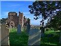 NU1241 : Lindisfarne Priory and graveyard by Gordon Brown