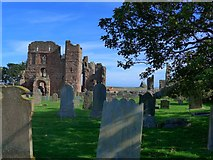NU1241 : Lindisfarne Priory and graveyard by Gordon Brown