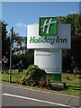 TQ5792 : Holiday Inn sign by Adrian Cable