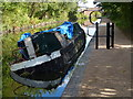 SP1391 : Burnt out narrowboat on the Birmingham & Fazeley Canal by Mat Fascione