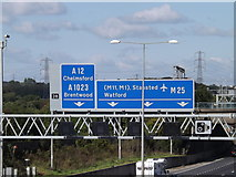 TQ5791 : Roadsigns on the M25 London Orbital Motorway by Geographer