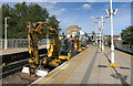 TQ2576 : Digging up the track, Parsons Green station by Des Blenkinsopp