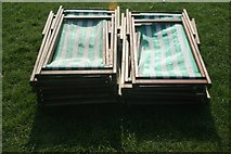 TQ2780 : View of two piles of deckchairs in Hyde Park by Robert Lamb