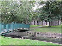 TQ2992 : Footbridge over Pymme's Brook near the Piccadilly Line viaduct in Arnos Park by Mike Quinn