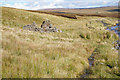 NY7533 : Ruined building alongside Trout Beck by Ian S
