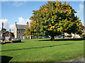 NY8677 : Village green at Wark by Trevor Littlewood