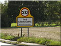 TM1160 : The Stonhams Village Name sign by Adrian Cable
