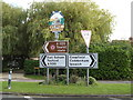 TM1659 : Roadsigns & Pettaugh Village sign off Ipswich Way by Adrian Cable