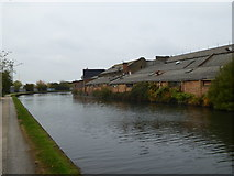 TQ2282 : Old industrial buildings beside the Paddington Branch of the Grand Union Canal by Rod Allday