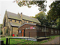 SE2432 : St Makarios church and hall, Farnley by Stephen Craven