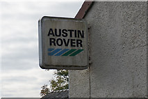 NY6727 : Austin Rover sign at Silverband Park, Knock by Ian S