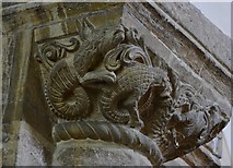 SP9599 : Wakerley: St. John the Baptist church: Monsters on the right hand Norman chancel arch capital 1 by Michael Garlick