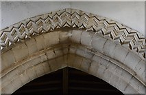 SP9599 : Wakerley: St. John the Baptist church: Zig zag Norman carving on the chancel arch 1 by Michael Garlick