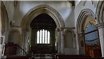 SP9599 : Wakerley: St. John the Baptist church: The Norman chancel arch and two blind arches by Michael Garlick