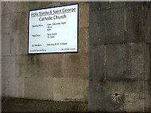 SD5192 : OS benchmark on Holy Trinity and St George RC Church, Kendal by Karl and Ali