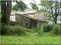 SD9772 : Stone building in corner of Kettlewell churchyard by Graham Robson
