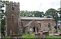 NY6325 : Stone masons restoring exterior of St Michael's Church by Roger Templeman