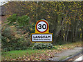 TM0231 : Langham Village Name sign on Birchwood Road by Adrian Cable