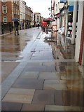 SO8554 : Wet High Street pavement by Philip Halling