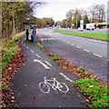 SJ8005 : Cycle route past a bus shelter, Cosford by Jaggery