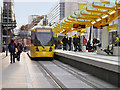 SJ8498 : Tram at Exchange Square Metrolink Stop by David Dixon