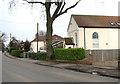 TG3211 : Woodbastwick Road past Methodist chapel conversion by Evelyn Simak