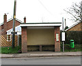 TG3211 : Bus shelter in Woodbastwick Road by Evelyn Simak