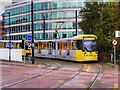 SJ8197 : Metrolink Tram at The Quays by David Dixon