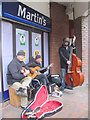 SP9211 : Buskers playing to pre-Xmas shoppers in Dolphin Square, Tring by Chris Reynolds