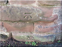 SJ4065 : Bench mark on the city walls in The Groves by John S Turner