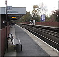 SJ7009 : Way out sign and bench, platform 1, Telford Central railway station by Jaggery