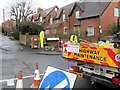 SP9111 : Erecting a new road sign in Miswell Lane, Tring by Chris Reynolds