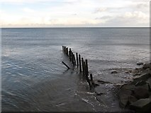 J3731 : The remains of a groyne at the mouth of the Shimna River by Eric Jones
