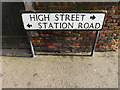 TL1714 : High Street & Station Road sign by Adrian Cable