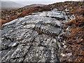 NN2063 : Rock Outcrop with Seams of Quartzite by Mick Garratt