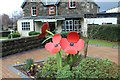 SH7667 : Remembrance poppies in Dolgarrog by Richard Hoare