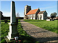 TF9316 : Longham War Memorial and church by Adrian S Pye
