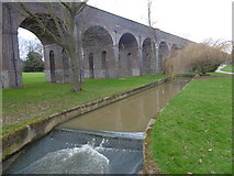 TQ2992 : Pymme's Brook in Arnos Park alongside the Piccadilly line by Marathon