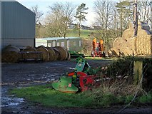 NU2422 : Farm yard west of Dunstan Steads by Andrew Curtis