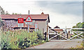 SK6590 : Level-crossing at site of Scrooby station, ECML 1992 by Ben Brooksbank