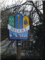 TM2899 : Brooke Village sign by Adrian Cable