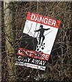 SS8379 : Warning notice on Cornelly Quarry boundary fence by eswales