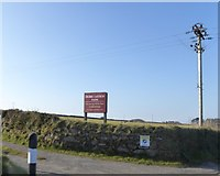 SW6836 : Sign and track for Higher Carthew Farm by David Smith