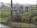 TM1554 : Hemingstone Village Name sign by Adrian Cable